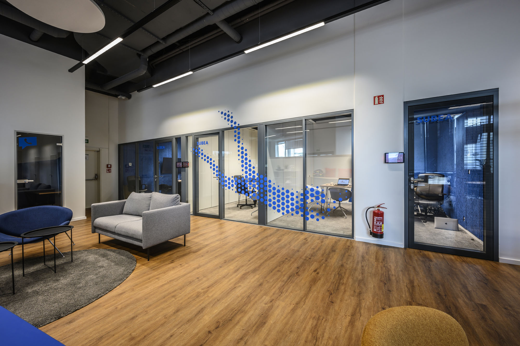 Modern flexible offices with graphic elements of various sports
